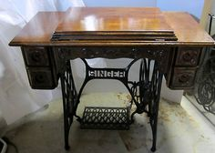 Antique Singer Ornate Treadle Sewing Machine Cabinet NOW With Stand on eBay!...cant believe i had 1 of these and sold it many yrs ago. what a dummy