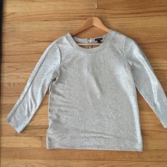 Ann Taylor Crewneck Foiled Top Ann Taylor silver and gold foiled top. 3/4 length sleeve, zips up the back. 17 inches from armpit to armpit. 100% polyester. Hand wash cold. Ann Taylor Tops Blouses