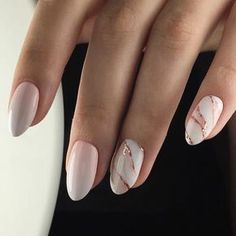 Light pink nails with white and gold marble details