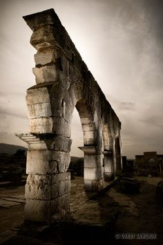 A ruined archway at the Roman ruins at Volubilis, Morocco
