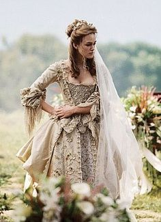 As a massive fan of the Pirates of the Caribbean...I fell in love with Elizabeth Swann's wedding dress in Dead Man's Chest. Absolutely stunning. Just as stunning as the beautiful Keira Knightley wearing it.