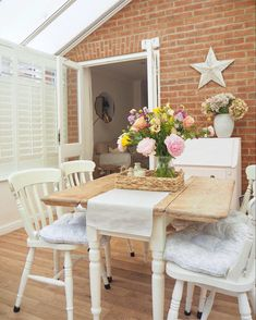 How diy plantation style shutters can transform a boring cold conservatory into a stylish sun room. Dining room interior style with exposed brick and cottage farmhouse style upcycled table and chairs. Sponsored post.