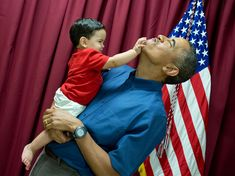 """2013: A Year in Photos-December 25, 2013 """"When little kids are around, you never know what will happen. See previous photograph."""" (Official White House Photo by Pete Souza)"""