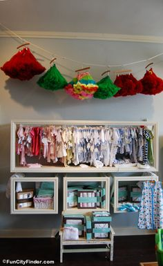 another adorable clothes line tutu display idea using hangers....love the display boxes underneath...could use crates, old drawers, baskets, etc this way