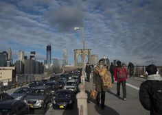 Commuters make their way across the Brooklyn Bridge in New York, October 31, 2012.