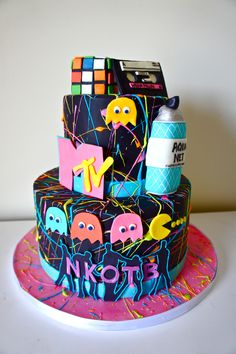 80's Theme cake for a 30th Birthday! Complete with MTV, Aqua Net Hairspray, Pac-Man, Rubik's Cube, Wilson Phillips cassette tape, and NKOTB