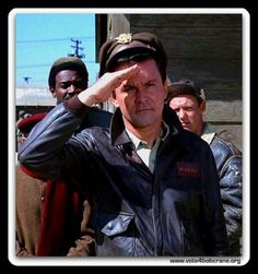 Dear gawd... Did no one ever teach Rob how to salute properly?? Was he making out with a nurse or secretary when boot camp was going on?? He looks like he shading his eyes searching for something... lol