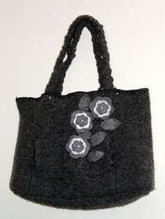 Hand Sewn Felted Gray Wool Sweater Tote Bag Felted Flowers. $28.00, via Etsy.