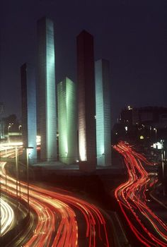 Rene Burri  MEXICO. Mexico City. Queretaro Highway. 1980.  The Towers of Satellite City (1957) by Mexican architect Luis BARRAGAN (and Mathias GOERITZ).Image ReferencePAR173706(BUR1980001K002) (Magnum)