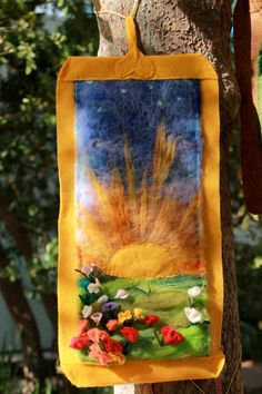 Sunrise needle felted wall hanging.