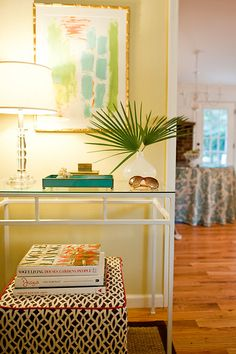 Elizabeth Newman + Foyer - fabulous colors tied together by the art work .