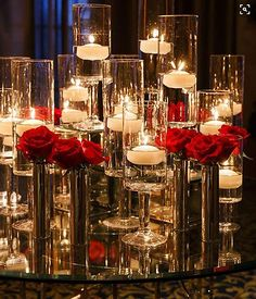 White floating candles are placed in tall glass stands and matched by metallic vases holding vibrant red roses. Like the idea but without red roses. Maybe white roses with glitter and red candles Red Rose Wedding, Wedding Flowers, Gold Wedding, Elegant Wedding, Trendy Wedding, White Tie Wedding, Wedding Colors, Wedding Mirror, Reception Decorations