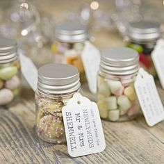 personalised wedding favour sweetie jar -    .    .     Fill with, mini chocolate eggs, dolly mix, mini marshmallows, white chocolate jazzies, jelly beans and sugar coated chocolate beans.
