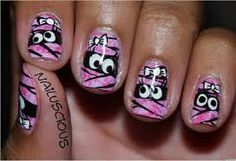 nail art; monster in hiding; pink and black; white details