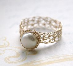 A freshwater pearl gold ring made in 14K gold filled wire, hand-crocheted to your specific size.  Using an ordinary crochet hook, I take fine