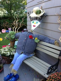 DIY scarecrow!  Stuff old clothes with straw, use an old rake or broom for the backbone and head!