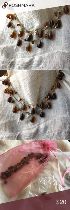 """Brown beaded gold-tone fair trade necklace Three tiered necklace from a very cool eco-friendly fair trade company, featuring brown tear-drop beads and sequins. This necklace was a gift and just not my style, but is gorgeous! Comes in a hand made jewelry bag; includes extra beads. 17"""" chain with 3"""" extender. Jewelry Necklaces"""