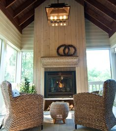 Cozy porch setting right by the fireplace.
