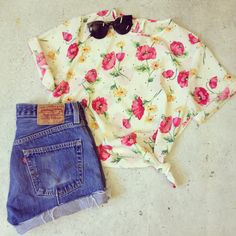 Floral and polka blouse paired with 501's
