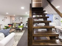 The custom open stairs are a bold and strong addition to the basement. Not only are they a wonderful design element, but they also serve a as room divider for the living room and dining room.