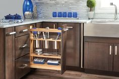 Rev-A-Shelf 448UT-BCSC-5C | Stop digging through drawers for utensils and say goodbye to unsightly, space monopolizing counter bins with the 448UT pullout designed specifically for storing a multitude of utensils.