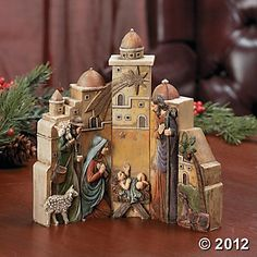 Nativity scene with town backdrop