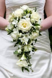 Risultati immagini per bouquet cascata rose
