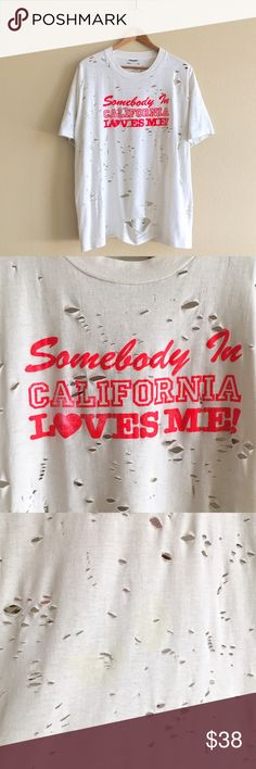 "80s / Long Distance Lover Tee ""Somebody in California Loves Me"" distressed tee. Has a few discolorations throughout, I have not tried to bleach it. Soft!   BRAND: Screen Stars MATERIAL: 50/50 YEAR/ERA: 80s LABEL SIZE: XL BEST FIT: L  MEASUREMENTS: Chest 24.5 inches Length 28 inches   → Style inspiration:  ☒ I do not model or trade, sorry! ❁ Check out my closet for more vintage! UNIF Tops Tees - Short Sleeve"