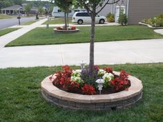 both front yard trees stone borders with flowers completed - Backyard Landscape Ideas