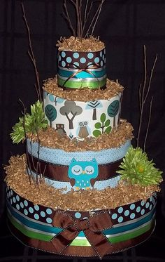 Owl Diaper Cake... but I'm thinking this would be a cute real cake, toasted coconut on top!
