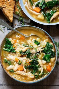 Tuscan Style Chicken Soup - a hearty soup with veggies and beans to warm up your belly! Gluten free too.