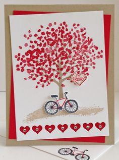 Stampin' Up! ...handmade Valentine card ... Sheltering Tree dressed in red ... border of negative space hears with shiny peals in the centers ... great card with matching envelope ...