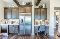 Built-in kitchen desk with TaylorCraft Cabinet Door Company mitered cabinet doors in MW6 frame and flat panel in hard maple with gray stain
