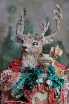 Deer child with his cello and Frog Doll