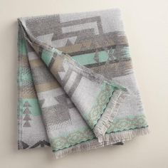 One of my favorite discoveries at WorldMarket.com: Blue Tribal Throw with Fringe