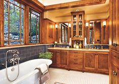 Prairie-style casement and clerestory windows and cabinets are in keeping with this contemporary Craftsman bathroom redo. Windows: Kolbe & Kolbe