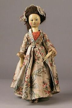 Queen Anne Wooden Doll, England, c. 1780, black pupil-less glass eyes, stylized line and dot