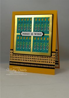 Blog Post Date:  August 30, 2017.  An alternative use for the window thinlits included with the Window Box Thinlits.  Othere elements of this card include:  Window Shopping stamp set, Gold Foil Sheets, Calypso Coral Ombre ribbon, Island Indigo Ombre ribbon, Lemon Lime Twist Ombre ribbon, Crushed Curry Mini Chevron ribbon, Pick A Pattern Washi Tape, Classic Label punch, and the additional colors of Bermuda Bay, Basic Black, and Dapper Denim.