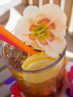 Cuba libre. Dress up a Rum and Coke with a flower garnish