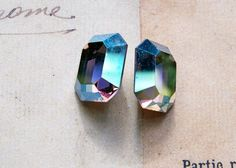 Two 12 X 10mm Octagon Swarovski crystals, Dark Silver AB $4.00 #thecraftstar #supplies #swarovski #vintage #octagon #ab #cabochons #dark #silver