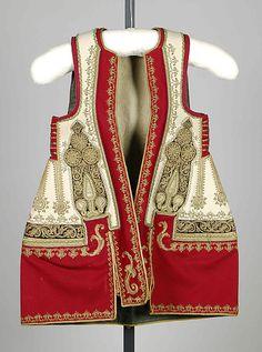 Women's coat.  Albanian, 1890 to 1910.  Wool, metal, silk, sequins.  (Met Museum, N.Y.).