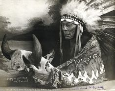 Montana 1928. Photograph of Cree Chief Mo-See-Ma-Ma-Mos, Young Boy, holding a buffalo skull. He was western artist Charlie Russell's good friend and favorite model.