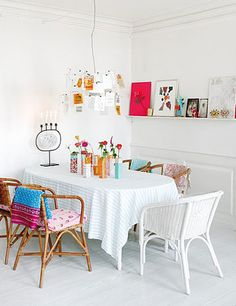 beautiful dining room... love the sheet as a tablecloth, the dft chairs, the chandelier made of pretty things.. love it all!