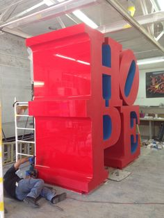"""Robert Indiana's """"HOPE"""" sculpture being painted in preparation for its NYC installation for the first annual International Hope Day on Saturday, September 13, 2014. #HopeDay #RobertIndiana #art #artist #museums #nyc #newyork"""