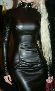 Blonde in fetish long sleeve black leather dress and choker collar
