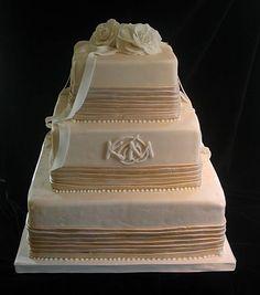 Wedding cake with pleats and monogram