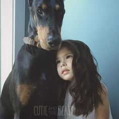 White Wolf : This little girl and her Doberman are everything a canine friendship should be