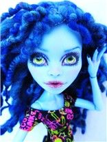 An Abby Bominable repaint from 2013. She has a full repaint and custom spun dreadlocks in electric blue.