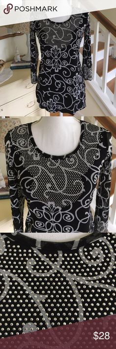 "INC International Black Bedazzled Rhinestone Top This beautiful black and white swirl top from INC International Concepts features 3/4 sleeves and rhinestones bedazzled around the neck and cuffs. Sleeves are sheer; front and back of shirt is solid. Size: Small. Chest: 17"". Waist: 15.5"". Length: 27.5"". #0007 INC International Concepts Tops"