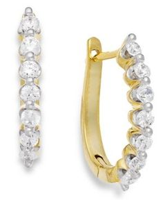 Diamond J-Hoop Earrings in 14k Gold (1/2 ct. t.w.).  The perfect diamond earrings. Simple beauty emulates from a stunning row of channel-set, round-cut diamonds (1/2 ct. t.w.) set in pristine 14k gold.